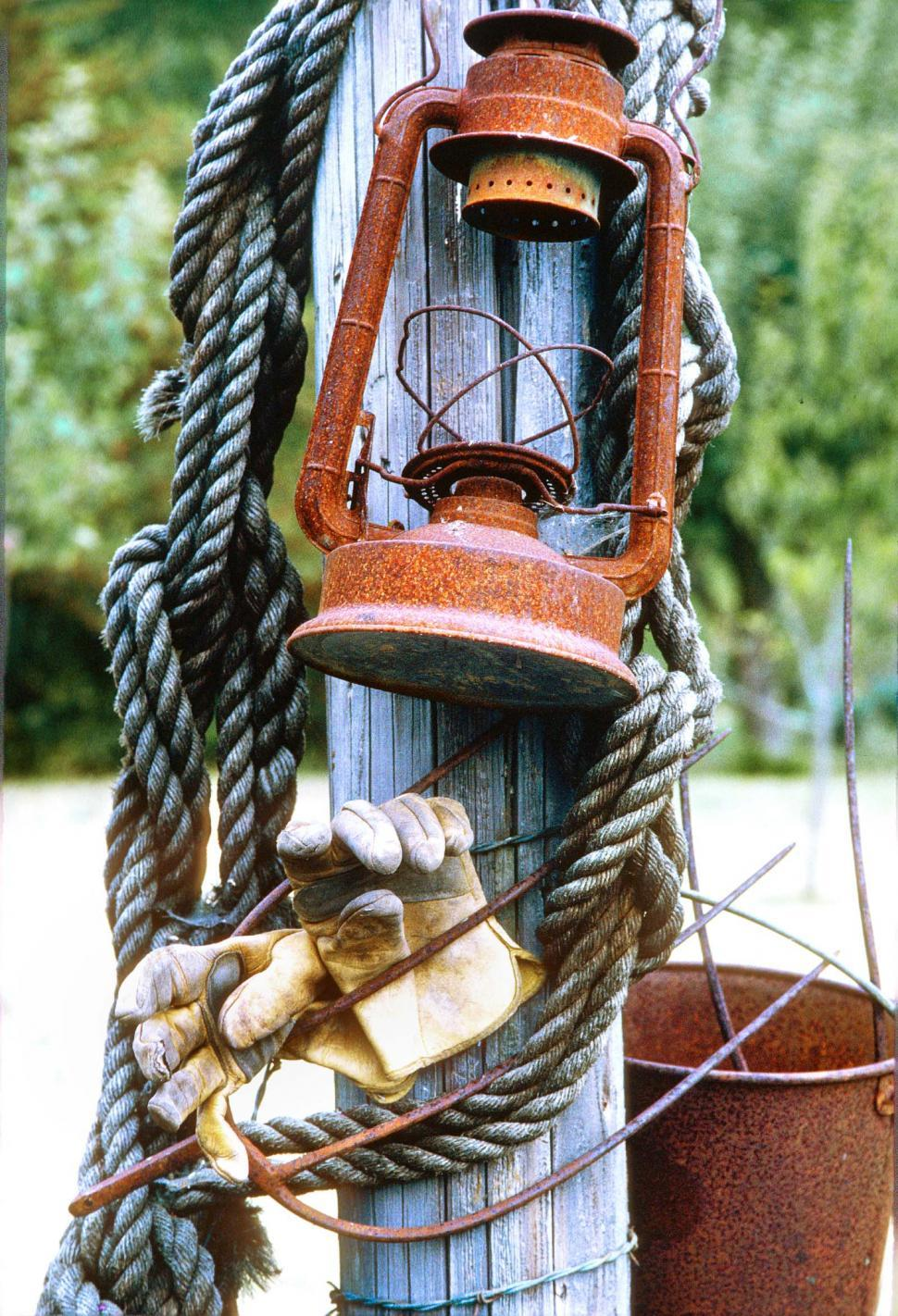 Download Free Stock HD Photo of Old lantern, rope, gloves Online