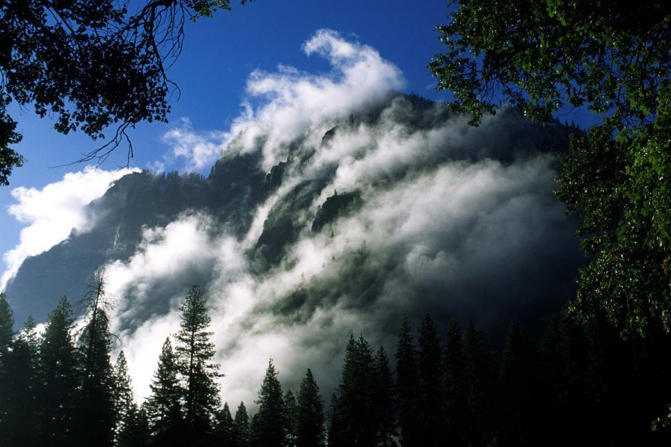 Download Free Stock HD Photo of Mist billows down mountain Online