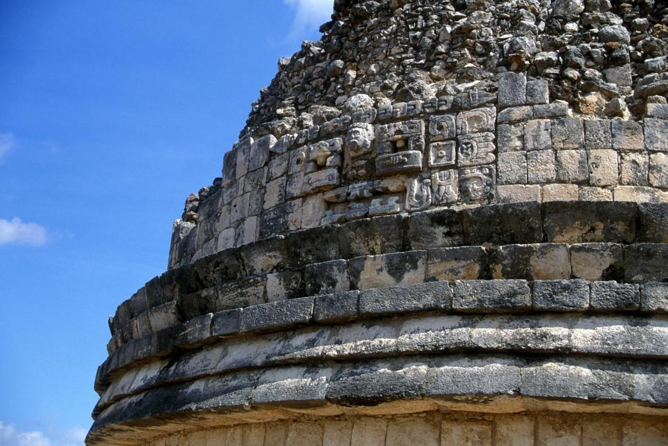 A Close Up Of An Ancient Mayan Building And The Detailed Artwork Carved Into Stone Architecture