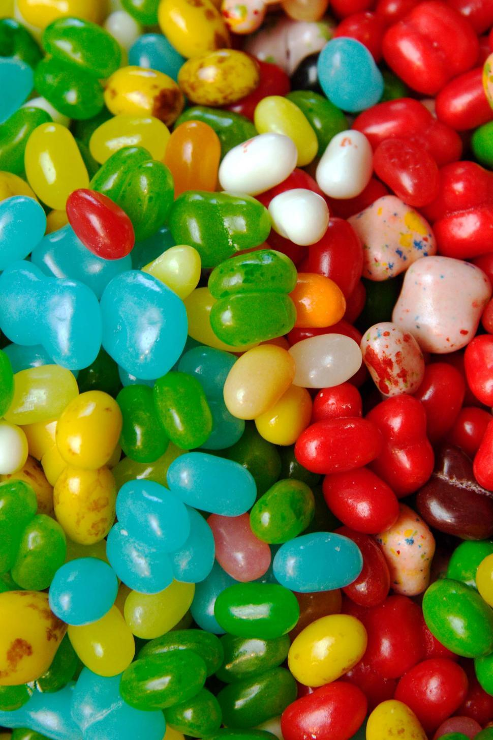 Free image of Many colored jelly beans make a background.