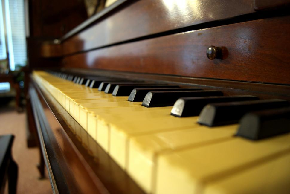 Download Free Stock HD Photo of Close up of an Older Piano Online