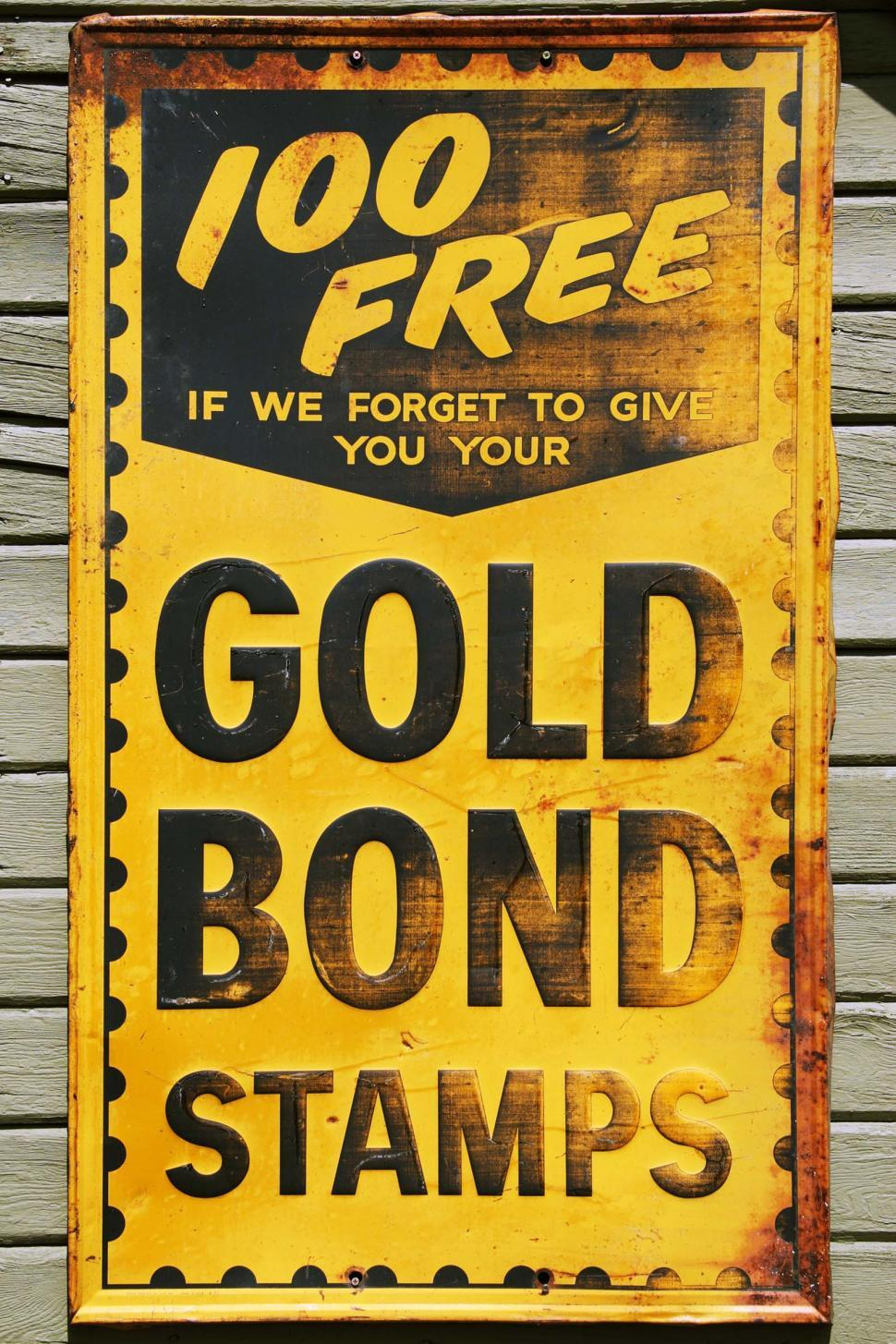 Download Free Stock HD Photo of Gold Bond Stamp sign Online