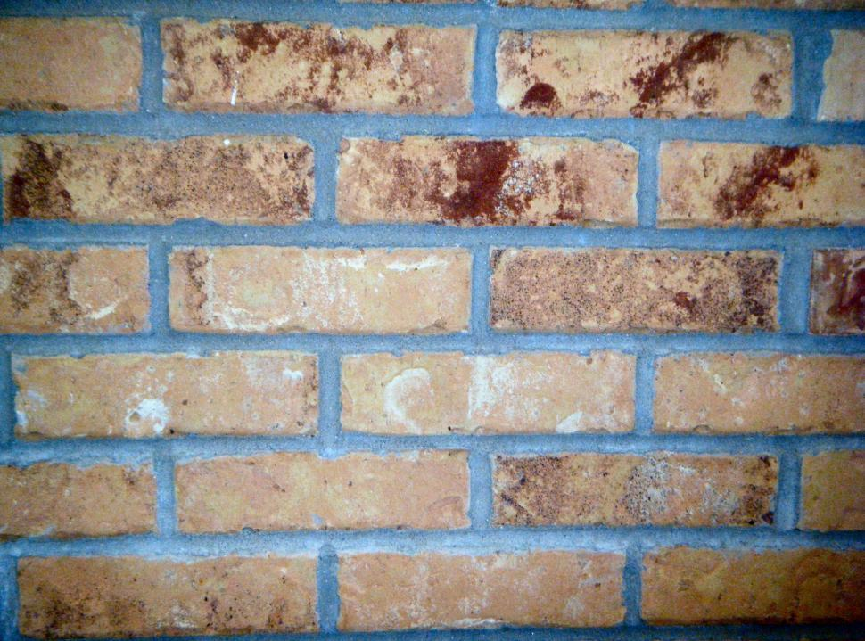 Download Free Stock HD Photo of Light colored Brick wall section close up Online