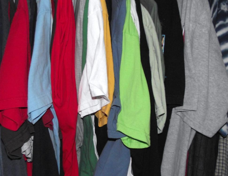 Download Free Stock HD Photo of T-shirts hanging in a row Online