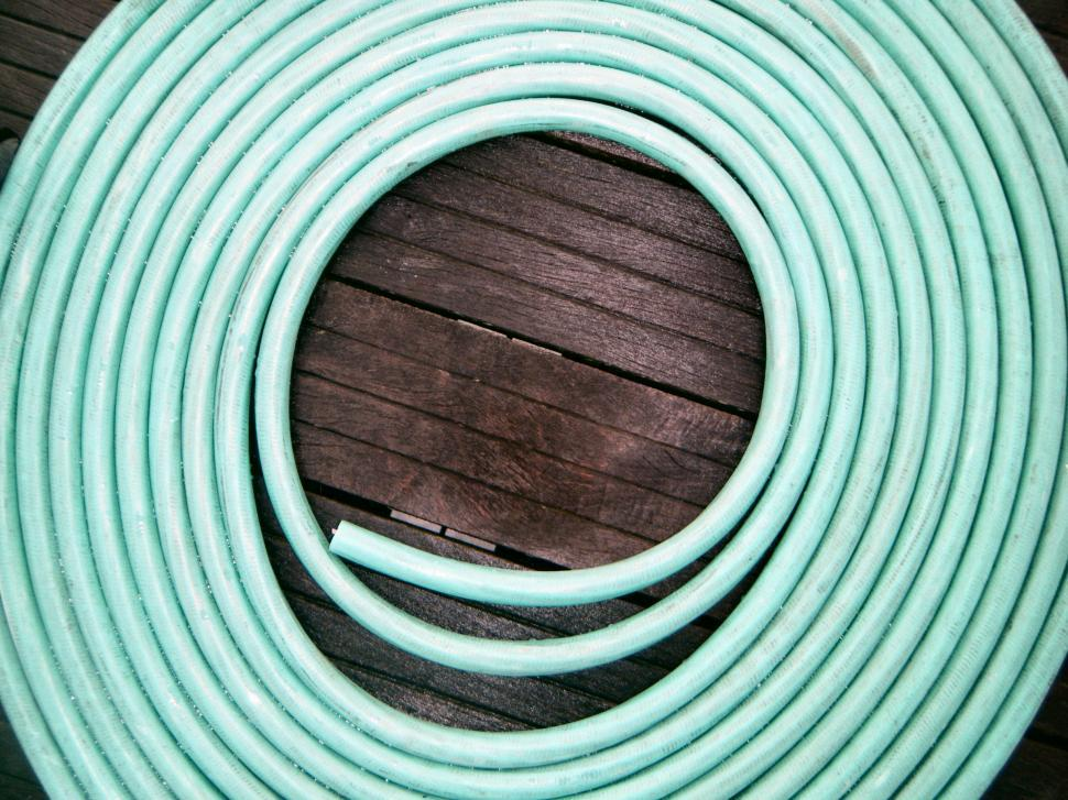 Download Free Stock HD Photo of Coil of rubber water hose lying on a deck - green Online