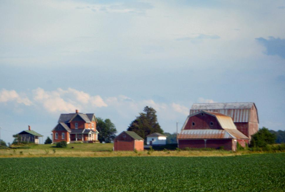 Download Free Stock HD Photo of Dairy farm with cows, silos, corn fields, barns, sheds, and farmhouse Online