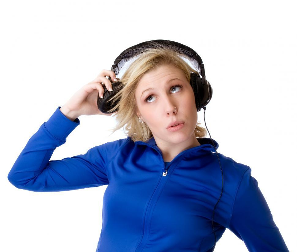 Download Free Stock HD Photo of Young woman listens on one side Online