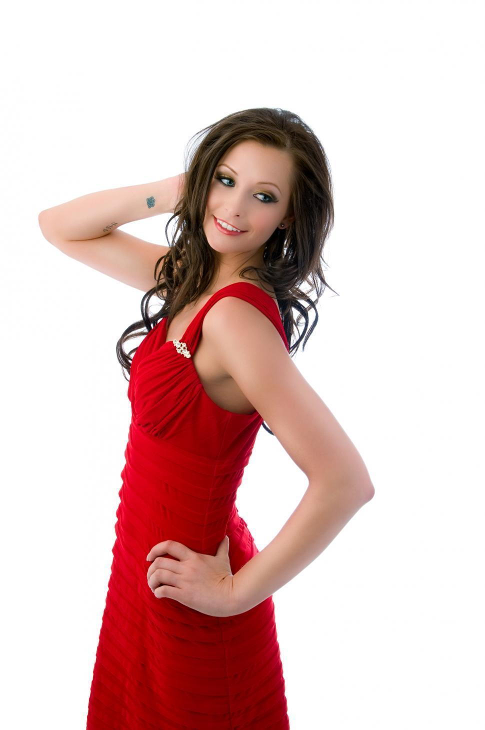 Download Free Stock HD Photo of Young woman in red dress standing Online