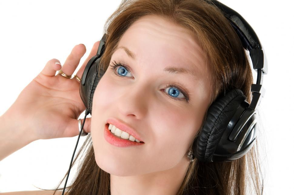 Download Free Stock HD Photo of Young woman listening to music Online
