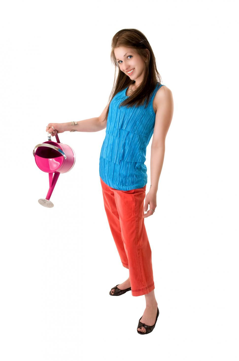 Download Free Stock HD Photo of Young woman with watering can Online