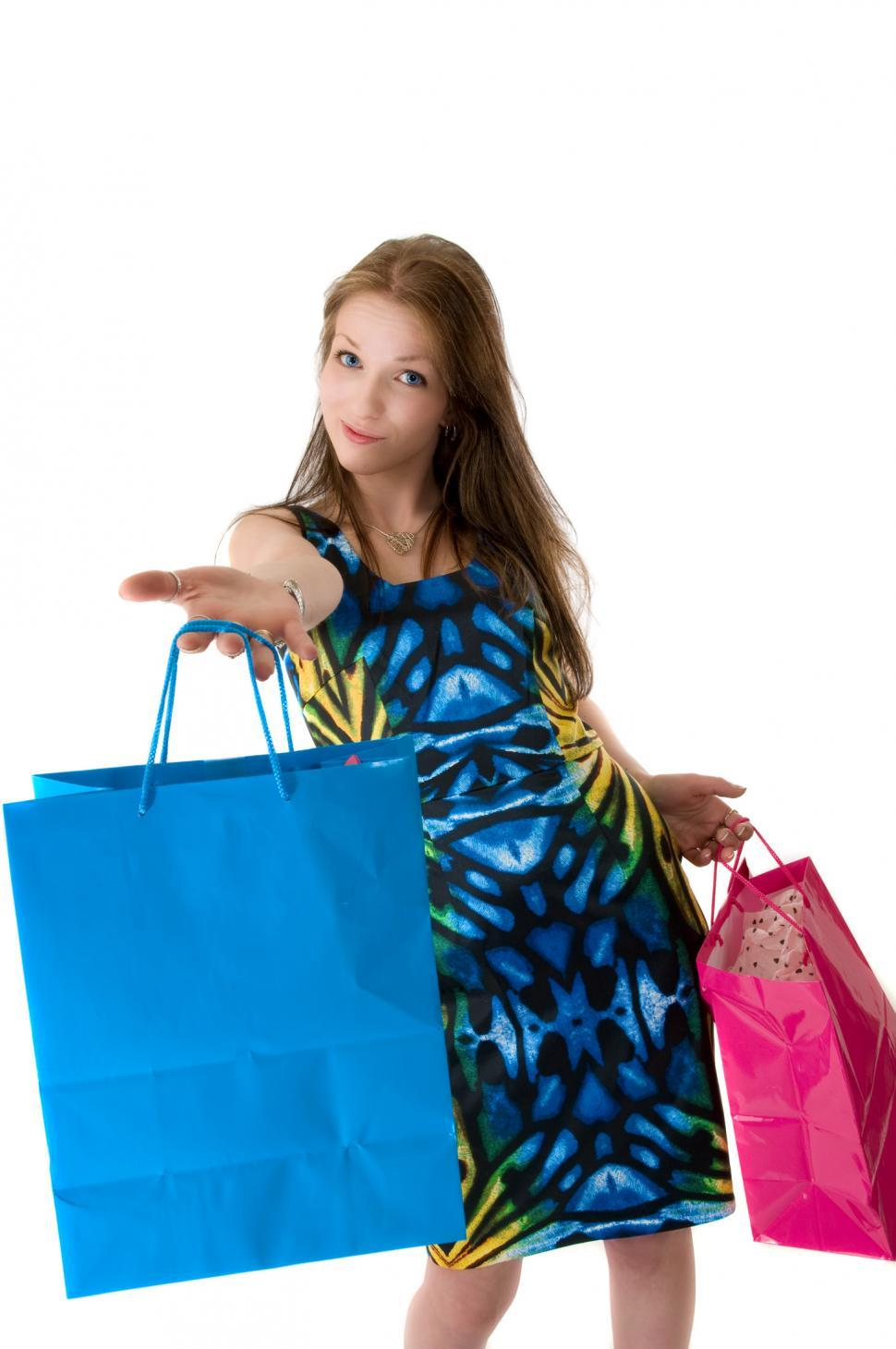 Download Free Stock HD Photo of Young shopper hands to camera Online
