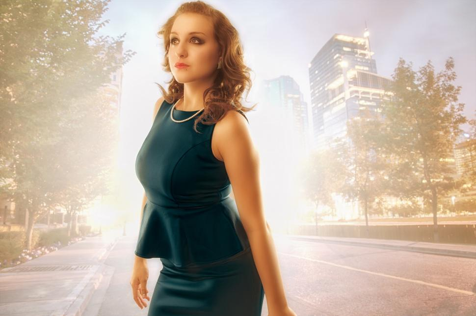 Free image of Professional looking woman over city background