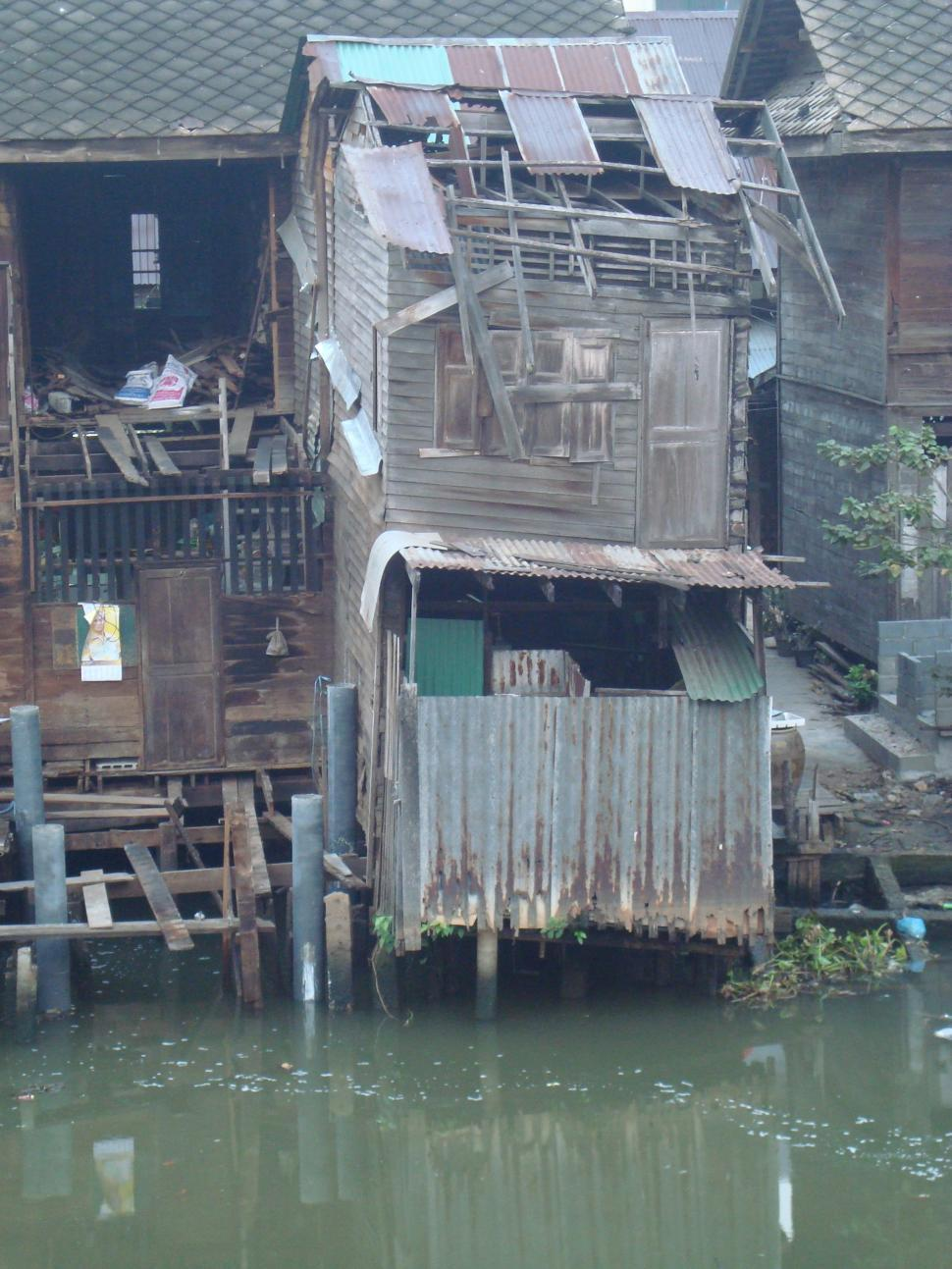 Download Free Stock HD Photo of Riverside Slum House Online