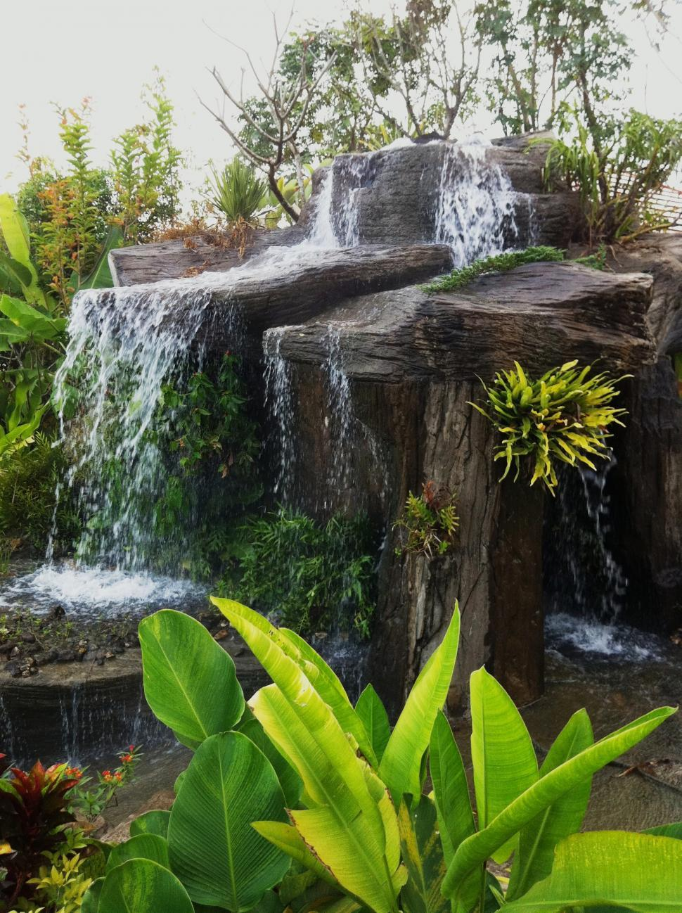 Download Free Stock HD Photo of Tropical Garden Waterfall Feature Online