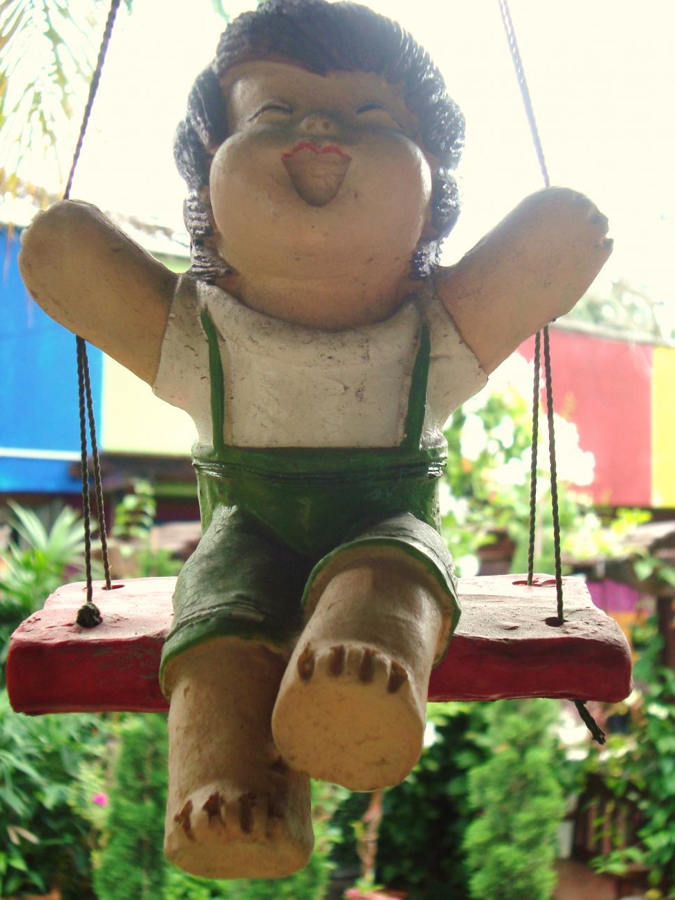 Download Free Stock HD Photo of Boy Swing Garden Decoration Online