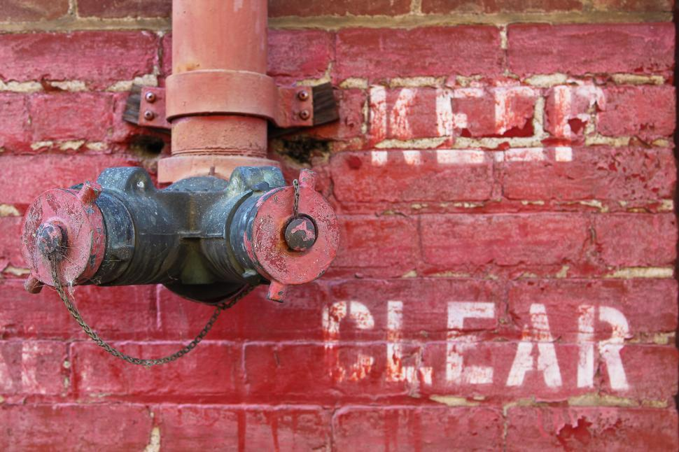 Download Free Stock HD Photo of Fire Hydrant on a Wall Online