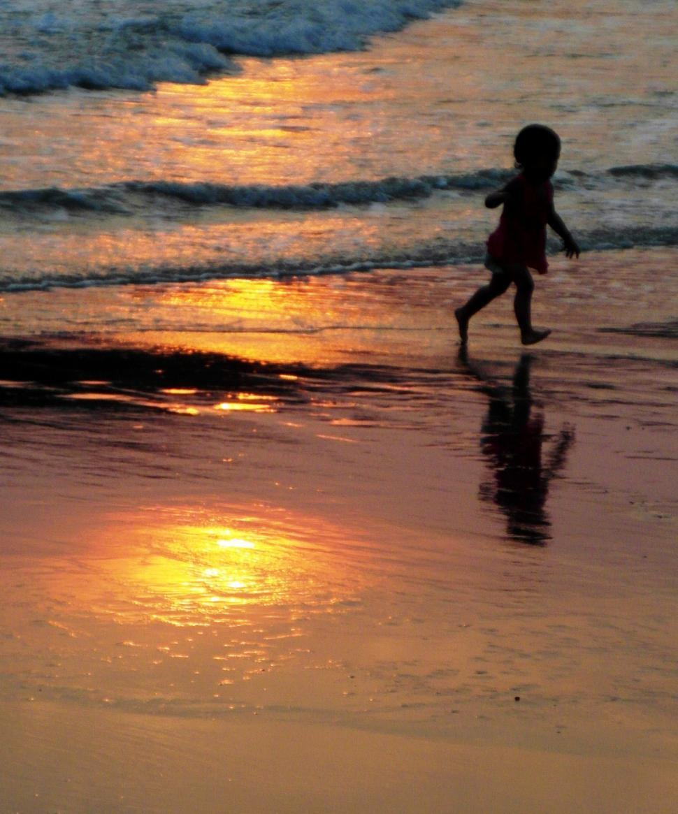 Download Free Stock HD Photo of Child Running on Beach at Sunset Online
