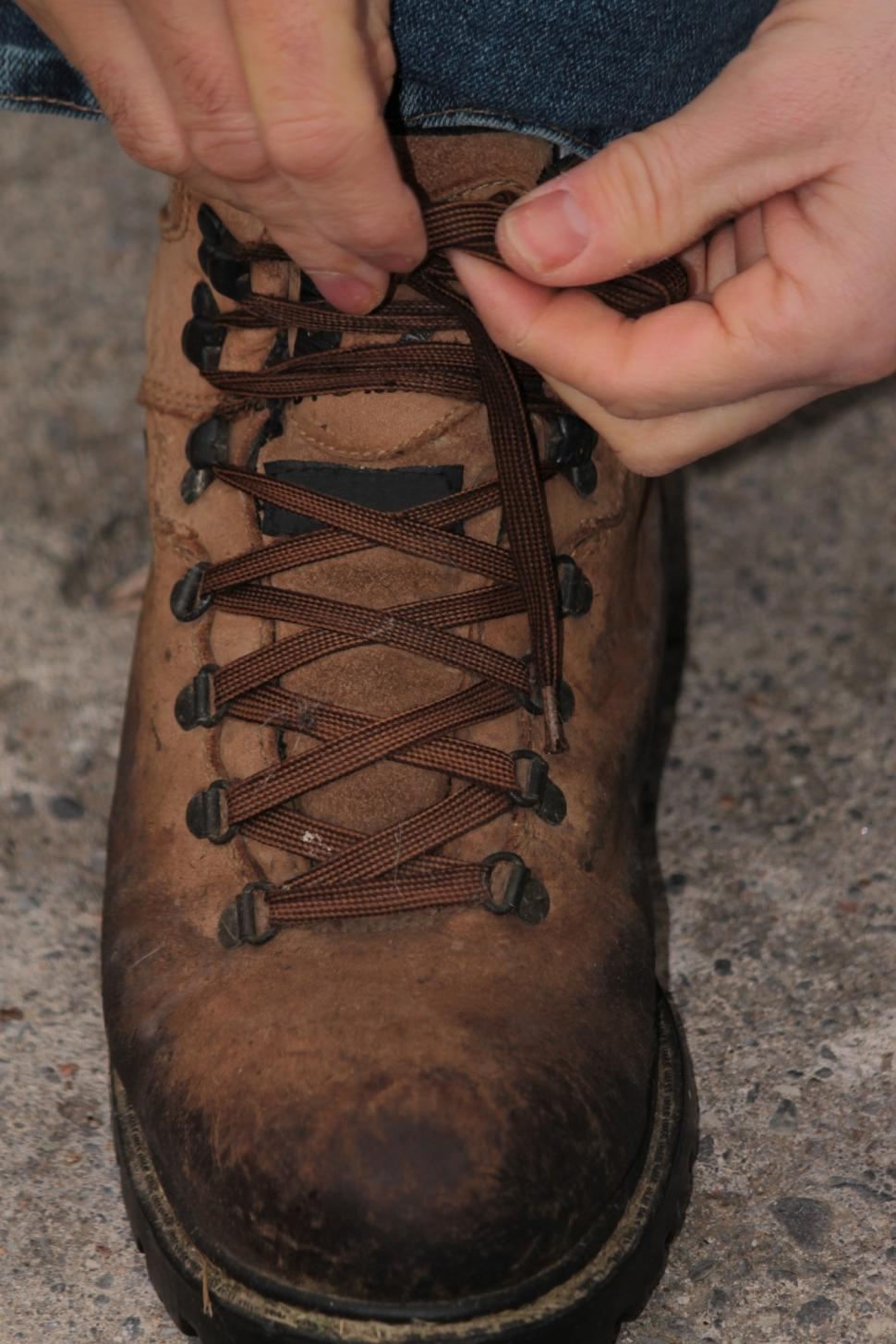 Download Free Stock HD Photo of Tying work boots Online