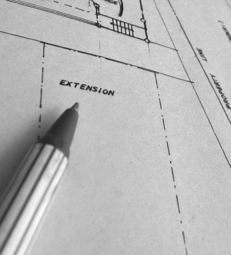 Download Free Stock HD Photo of Building Blueprint with pen Online