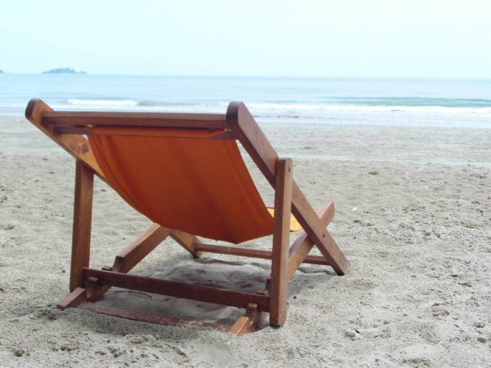 Download Free Stock HD Photo of Deckchair on an Empty Beach  Online