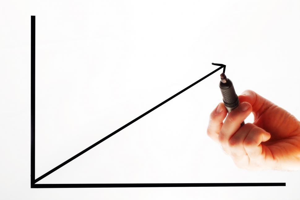 Free image of Person drawing a graph