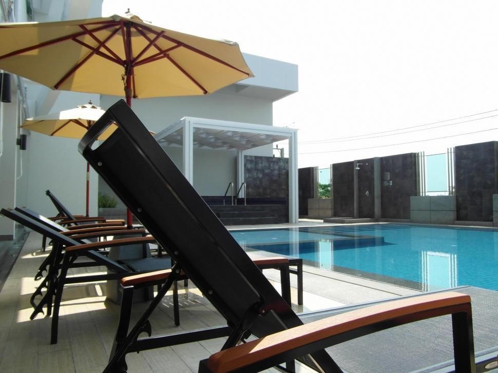 Download Free Stock HD Photo of Luxury Hotel Swimming Pool Online