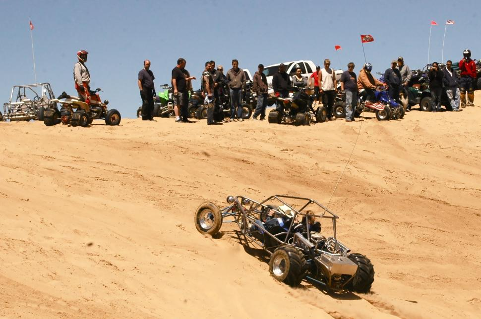 Download Free Stock HD Photo of Sand Buggy Climbs Dunes in Colorado Online