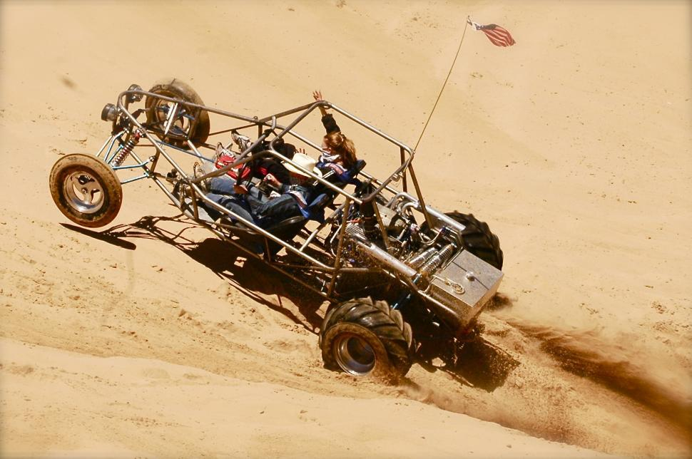 Download Free Stock HD Photo of Dune Buggy Hill Climbs the Sand Dunes Online