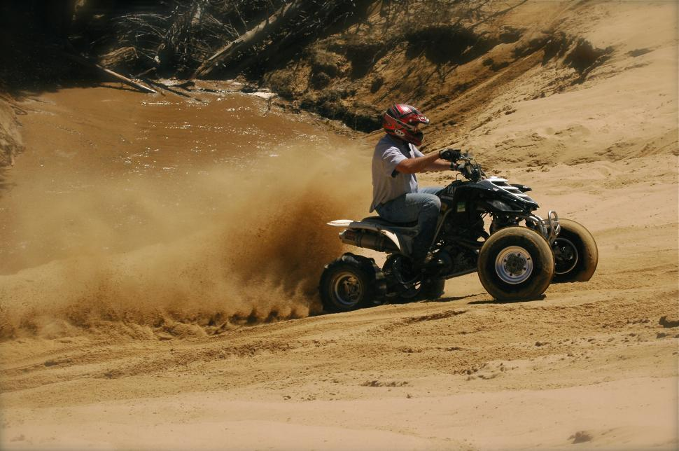 Download Free Stock HD Photo of ATV Climbs Sand Hill Online