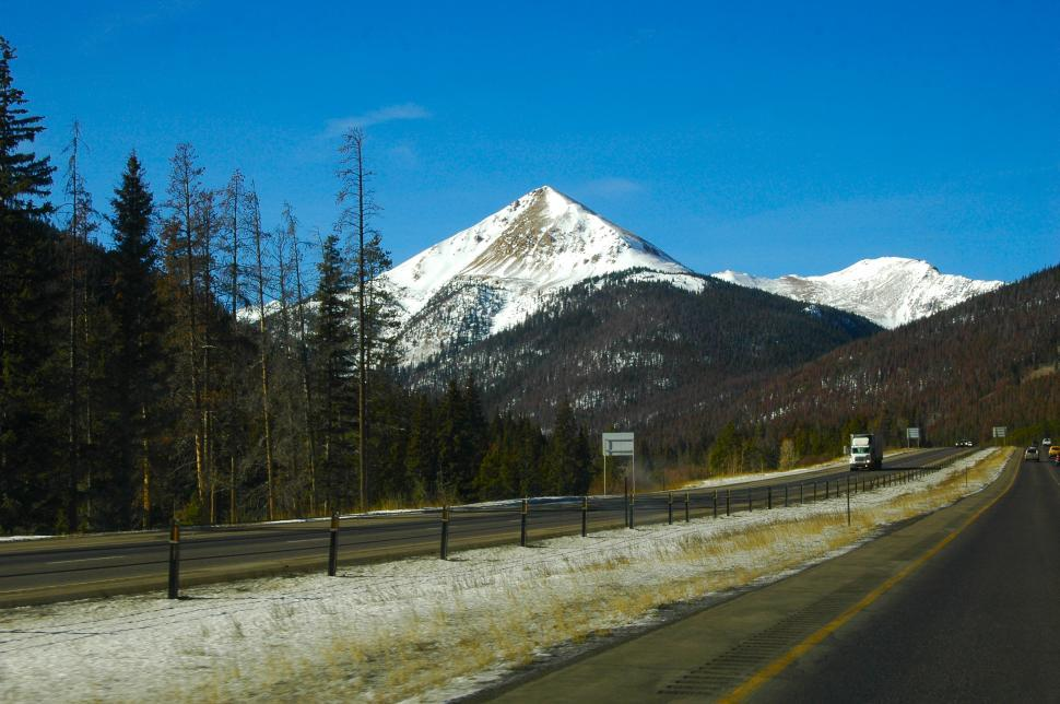 Download Free Stock HD Photo of Mountain Highway through the Snow Capped Mountain Online