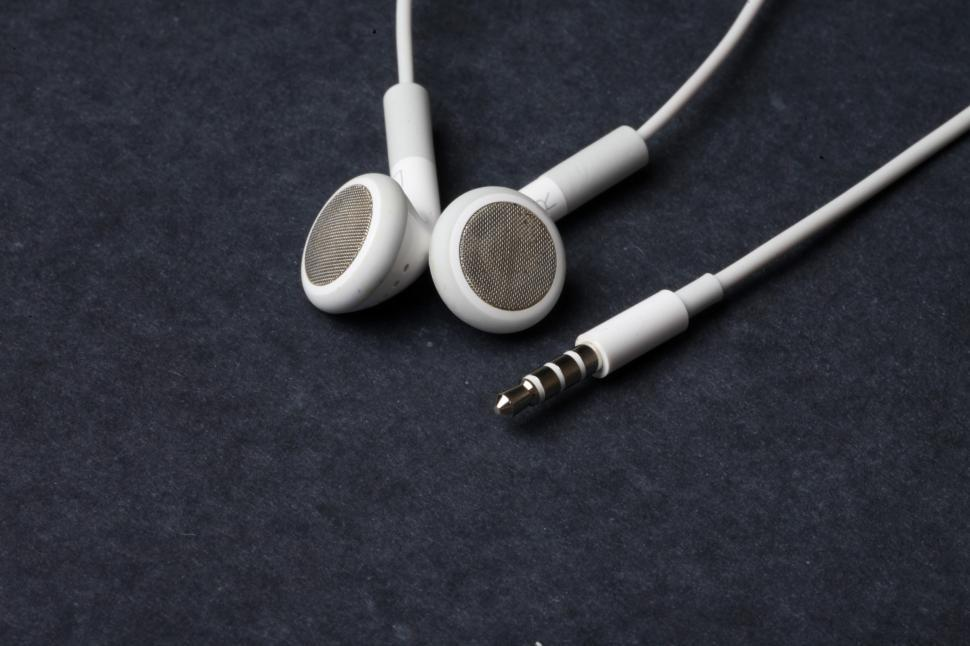 Download Free Stock HD Photo of White earphones on black background Online