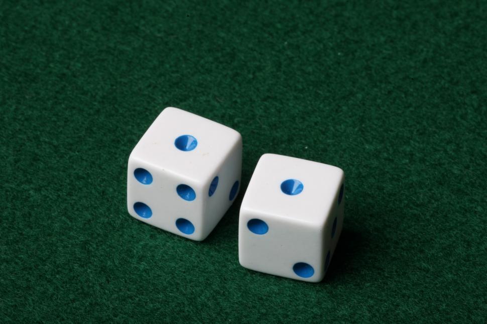 Two dice on green felt