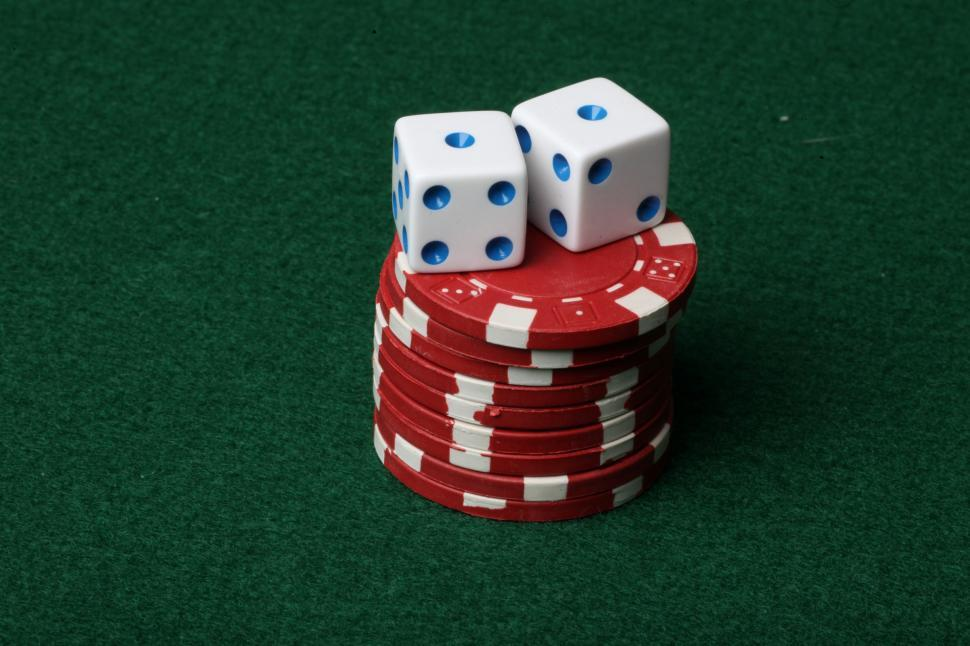 Two dice on red poker chips