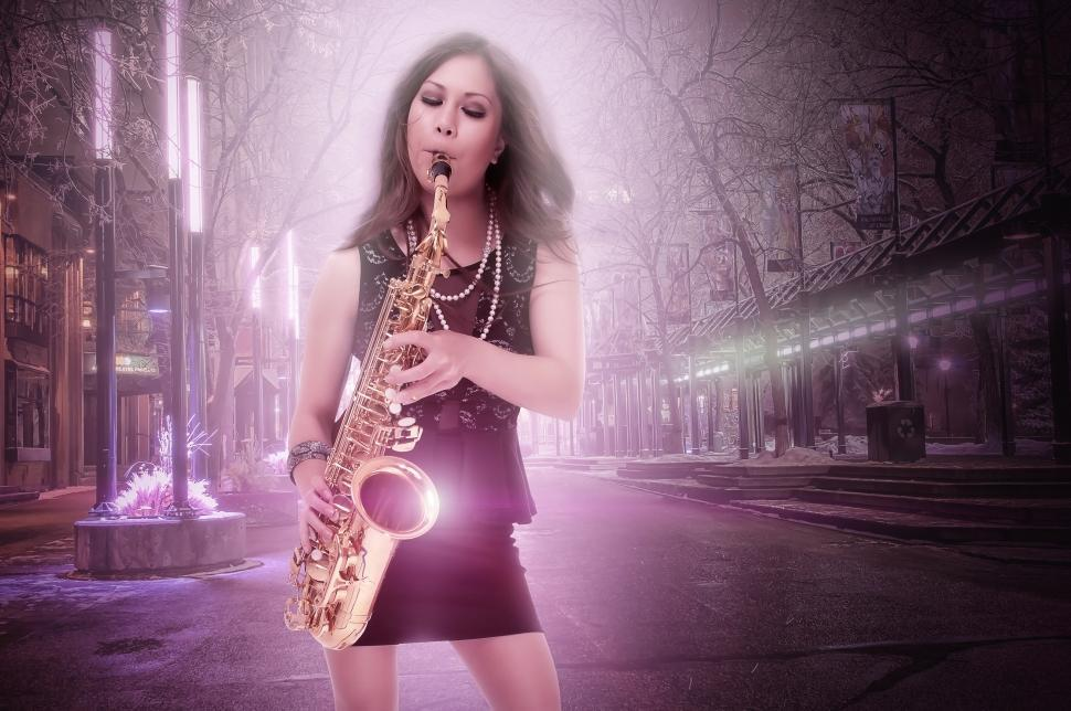Download Free Stock HD Photo of Woman plays saxophone in the city Online