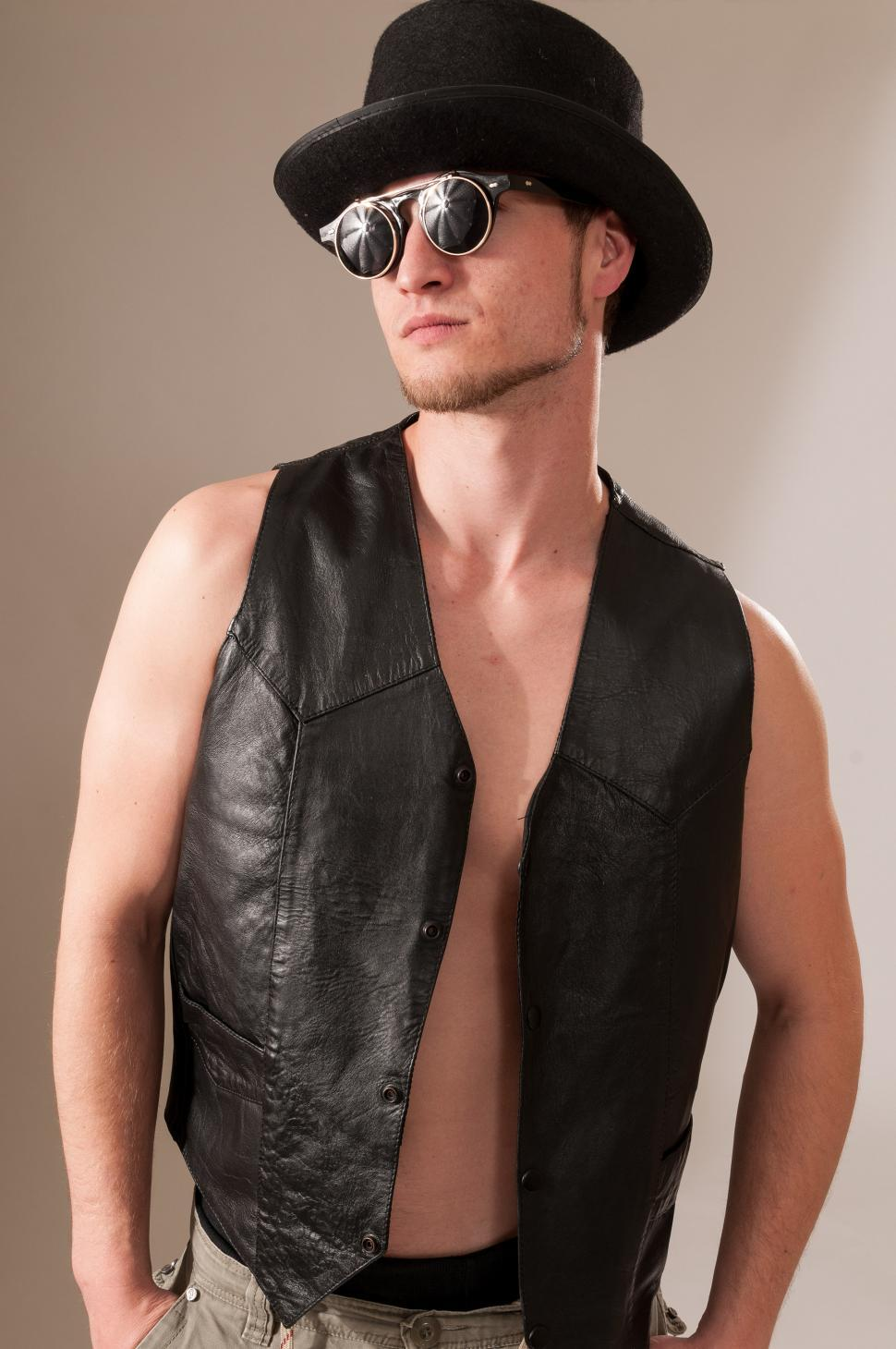 Download Free Stock HD Photo of Cool guy in a vest and top hat Online
