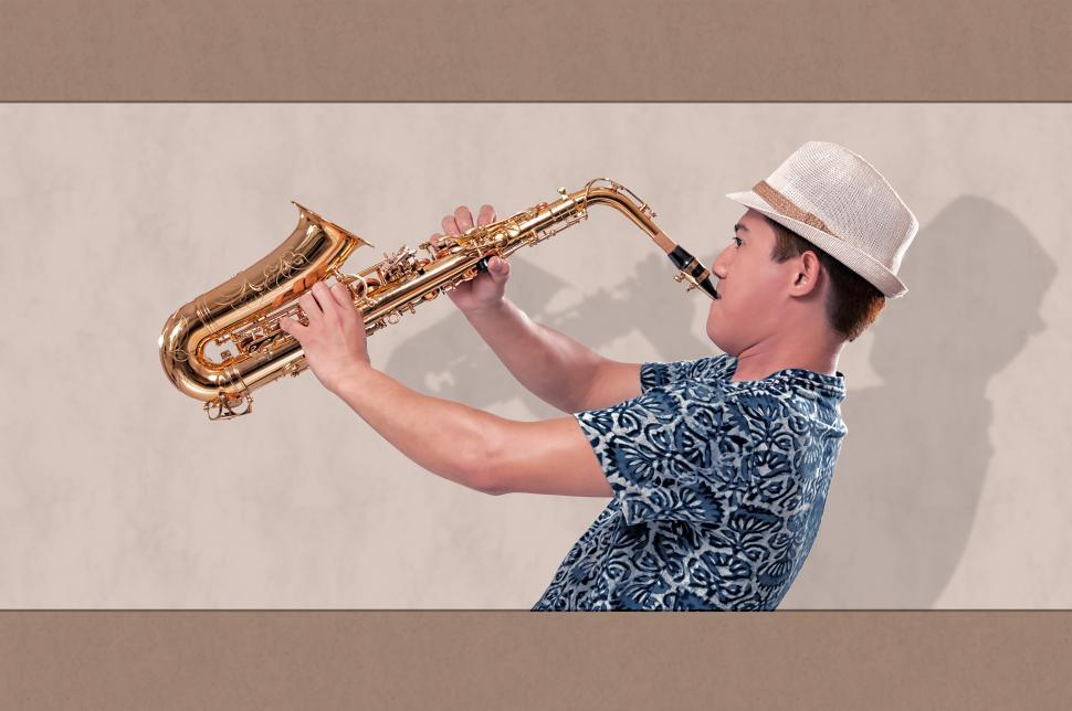 Download Free Stock HD Photo of Man on the saxophone Online