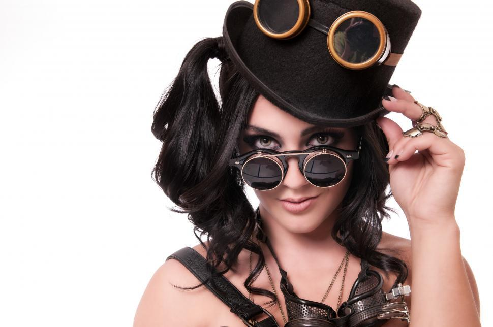 Download Free Stock HD Photo of Steampunk woman tips hat Online