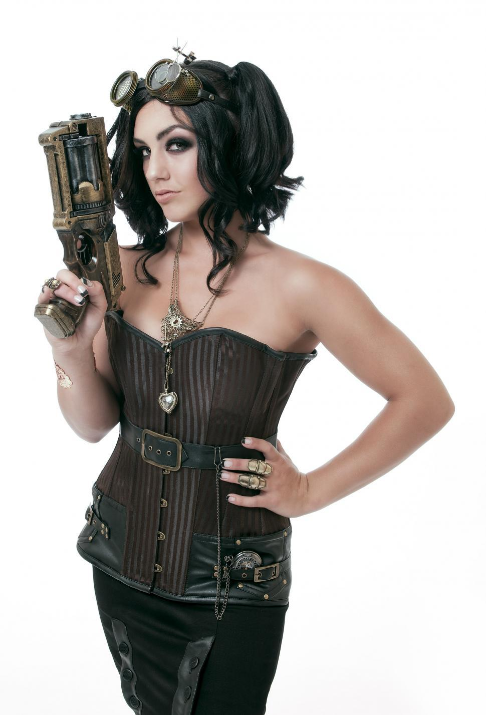 Download Free Stock HD Photo of Dressed up woman with steampunk gun Online