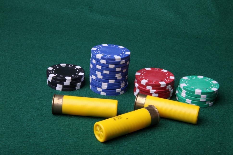 Download Free Stock HD Photo of Ammo and poker chips Online