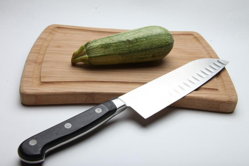 Download Free Stock HD Photo of Wooden Cutting Board and Knife Online