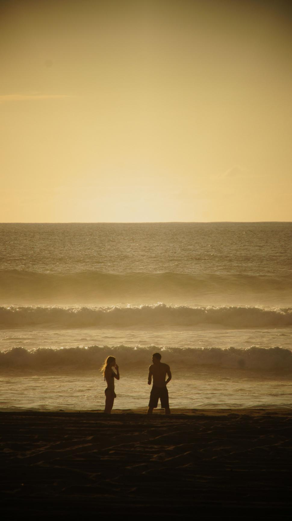 Download Free Stock HD Photo of Couple in the Sunset Online