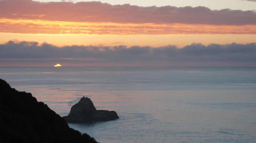 Download Free Stock HD Photo of Sunset over the Mountain Coastline Online