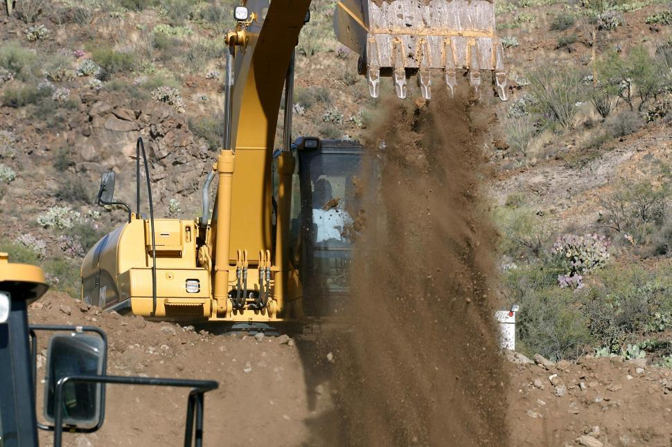Download Free Stock HD Photo of Dumping scoop of dirt Online