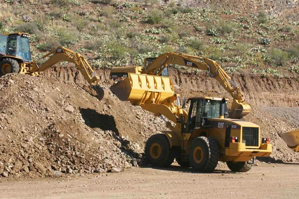 Download Free Stock HD Photo of Excavators and front loaders at work Online