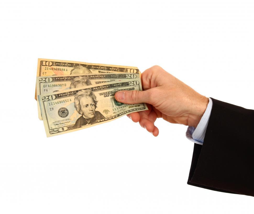 Download Free Stock HD Photo of A Hand Holding Money Online