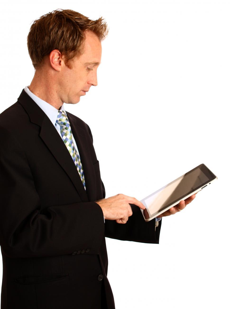 Download Free Stock HD Photo of A young businessman holding a tablet computer Online
