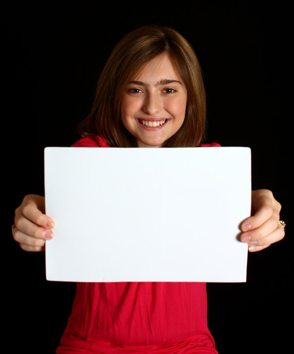 Download Free Stock HD Photo of A cute young girl holding a blank sign Online