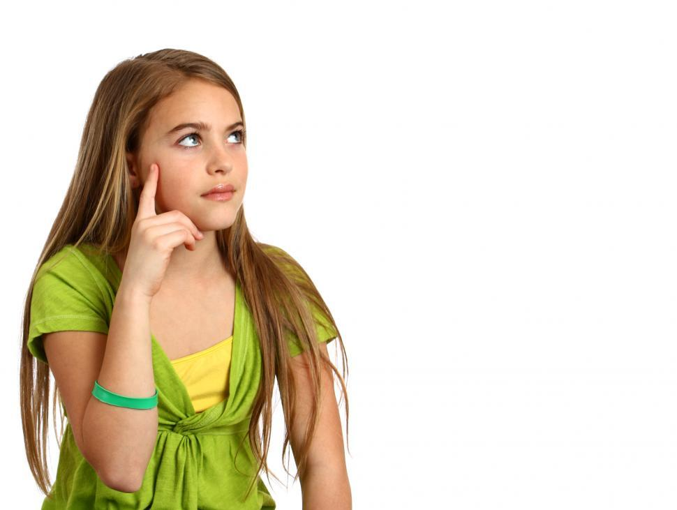 Download Free Stock HD Photo of A beautiful young girl with a thoughtful expression Online