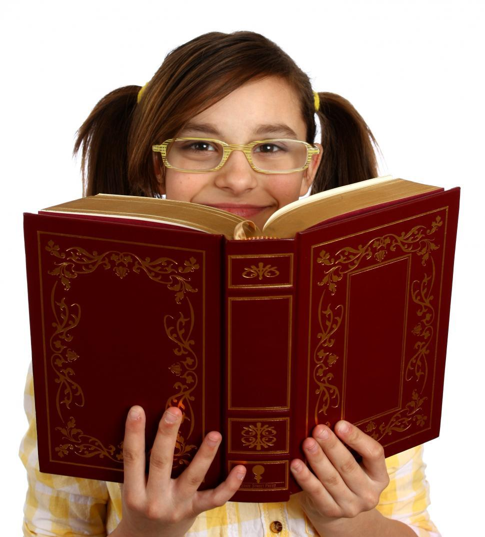 Download Free Stock HD Photo of A smart girl with glasses reading a book Online