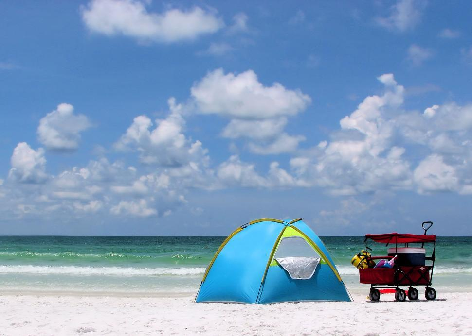 Download Free Stock HD Photo of A tent and buggy on a beach Online